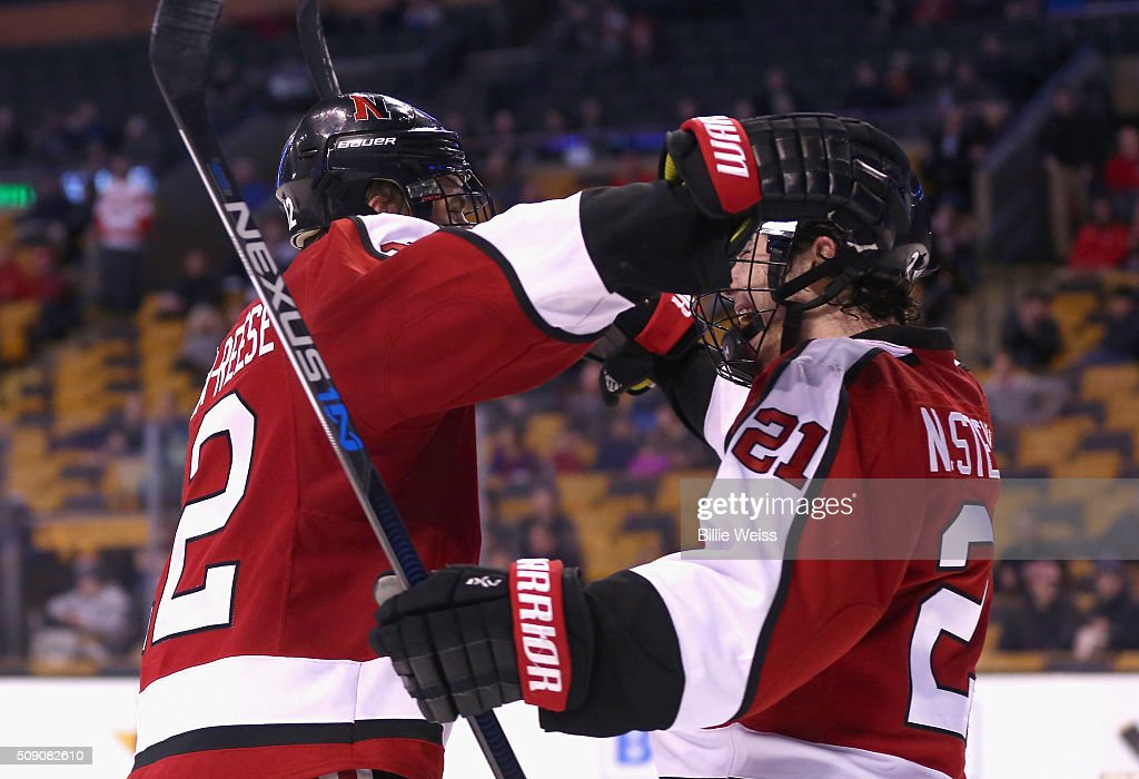 Zach Aston-Reese #12 of Northeastern University reacts with Nolan Stevens #21 after scoring a goal against Harvard University during the second period of the Beanpot Tournament consolation game at TD Garden on February 8, 2016 in Boston, Massachusetts.