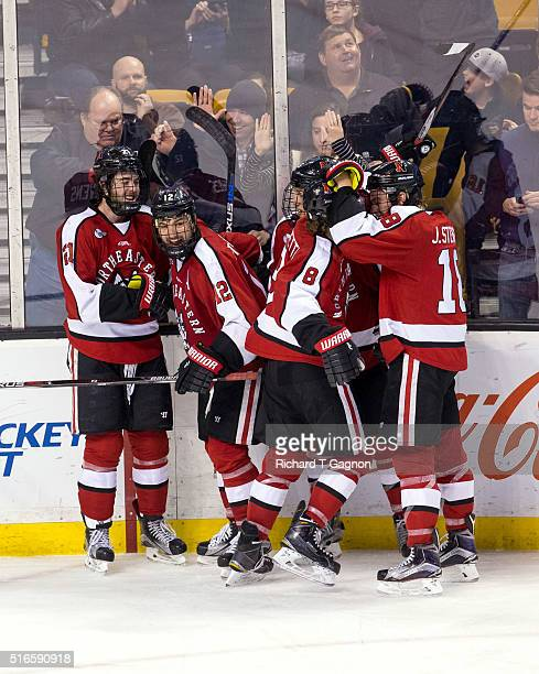 Zach AstonReese of the Northeastern Huskies celebrates after scoring the eventual gamewinning goal against the Massachusetts Lowell River Hawks with...