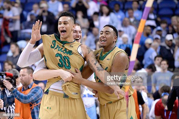 Zach Auguste Bonzie Colson and the Notre Dame Fighting Irish celebrate after defeating the North Carolina Tar Heels during the championship game of...