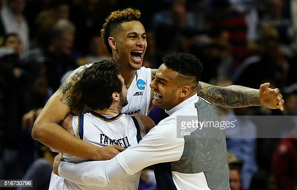 Zach Auguste of the Notre Dame Fighting Irish and teammates celebrate their 76 to 75 win over the Stephen F Austin Lumberjacks during the second...