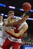 Zach Auguste of the Notre Dame Fighting Irish collides with Ethan Happ of the Wisconsin Badgers in the second half during the 2016 NCAA Men's...