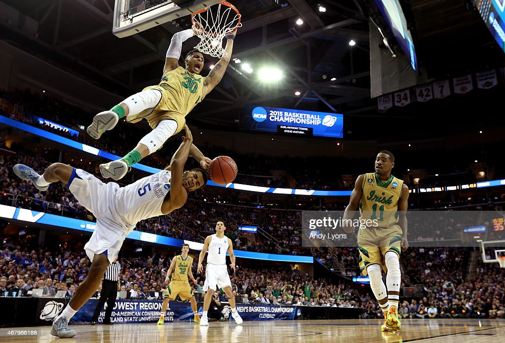 Zach Auguste of the Notre Dame Fighting Irish dunks over Andrew Harrison of the Kentucky Wildcats in the second half during the Midwest Regional...