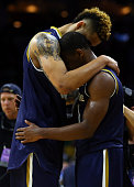Zach Auguste of the Notre Dame Fighting Irish hugs teammate Demetrius Jackson after being defeated by the North Carolina Tar Heels with a score of 74...