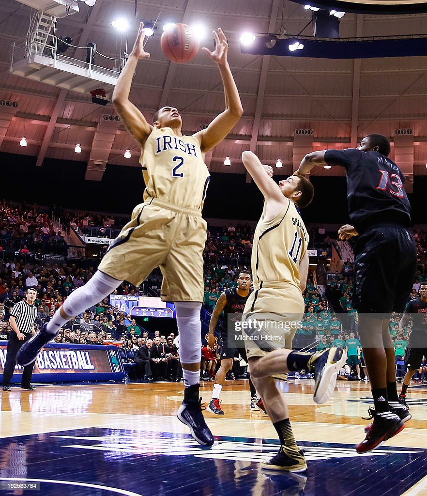 Zach Auguste #2 of the Notre Dame Fighting Irish reaches for a rebound against the Cincinnati Bearcats at Purcel Pavilion on February 24, 2013 in South Bend, Indiana. Notre Dame defeated Cincinnati 62-41.