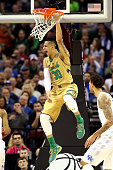 Zach Auguste of the Notre Dame Fighting Irish reacts after a dunk in the first half against the Kentucky Wildcats during the Midwest Regional Final...