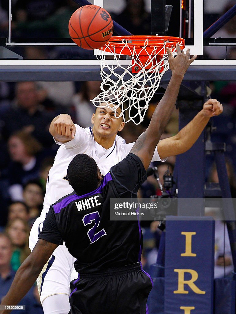 Zach Auguste #2 of the Notre Dame Fighting Irish rejects the shot of Devon White #2 of the Niagara Purple Eagles at Purcel Pavilion on December 21, 2012 in South Bend, Indiana.