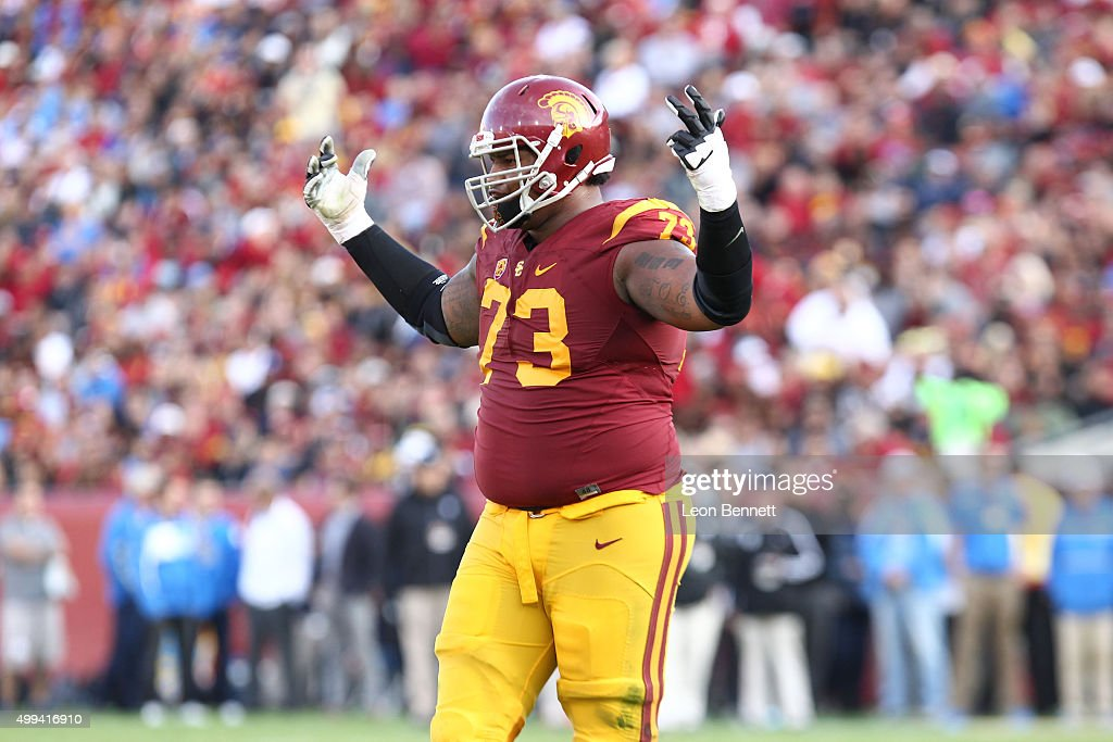 Zach Banner #73 of the USC Trojans celebrates after a 1st down against the UCLA Bruins a 40-21 Trojan win in a NCAA PAC12 college football game at Los Angeles Memorial Coliseum on November 28, 2015 in Los Angeles, California.