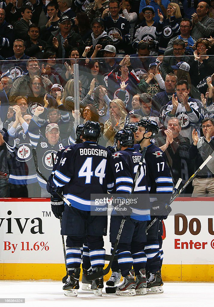 <a gi-track='captionPersonalityLinkClicked' href=/galleries/search?phrase=Zach+Bogosian&family=editorial&specificpeople=4195061 ng-click='$event.stopPropagation()'>Zach Bogosian</a> #44, <a gi-track='captionPersonalityLinkClicked' href=/galleries/search?phrase=Aaron+Gagnon&family=editorial&specificpeople=4537286 ng-click='$event.stopPropagation()'>Aaron Gagnon</a> #21 and James Wright #17 of the Winnipeg Jets celebrate a third period goal against the Florida Panthers with teammates at the MTS Centre on April 11, 2013 in Winnipeg, Manitoba, Canada.