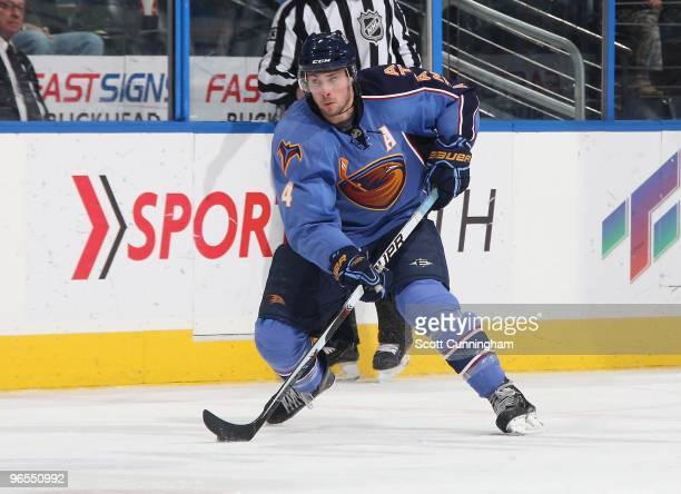 Zach Bogosian of the Atlanta Thrashers carries the puck against the Anaheim Ducks at Philips Arena on January 26 2010 in Atlanta Georgia