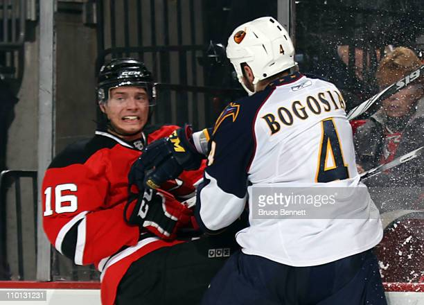 Zach Bogosian of the Atlanta Thrashers hits Jacob Josefson of the New Jersey Devils at the Prudential Center on March 15 2011 in Newark New Jersey