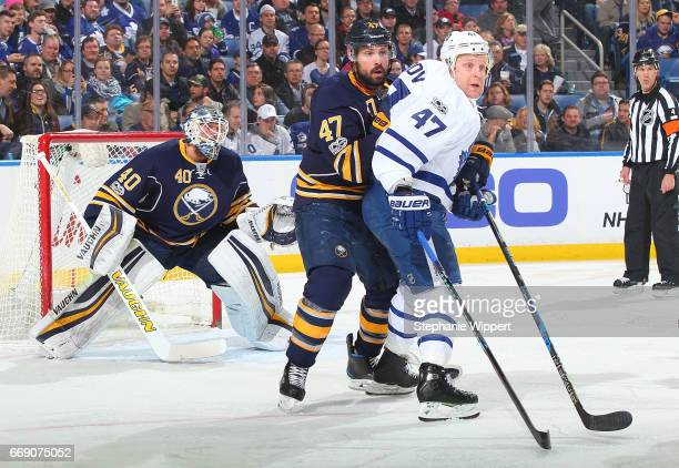 Zach Bogosian of the Buffalo Sabres defends against Leo Komarov of the Toronto Maple Leafs during an NHL game at the KeyBank Center on April 3 2017...