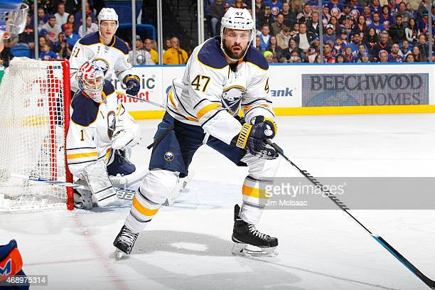 Zach Bogosian of the Buffalo Sabres in action against the New York Islanders on April 4 2015 at Nassau Veterans Memorial Coliseum in Uniondale New...