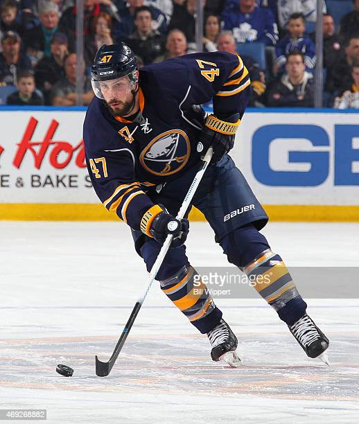 Zach Bogosian of the Buffalo Sabres skates against the Toronto Maple Leafs on April 1 2015 at the First Niagara Center in Buffalo New York