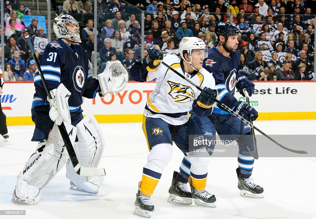 <a gi-track='captionPersonalityLinkClicked' href=/galleries/search?phrase=Zach+Bogosian&family=editorial&specificpeople=4195061 ng-click='$event.stopPropagation()'>Zach Bogosian</a> #44 of the Winnipeg Jets battles <a gi-track='captionPersonalityLinkClicked' href=/galleries/search?phrase=Gabriel+Bourque&family=editorial&specificpeople=5627917 ng-click='$event.stopPropagation()'>Gabriel Bourque</a> #57 of Nashville Predators as they set a screen in front of goaltender Ondrej Pavelec #31 during third period action at the MTS Centre on October 20, 2013 in Winnipeg, Manitoba, Canada.
