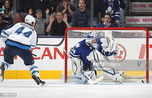 Zach Bogosian of the Winnipeg Jets buries the winning goal in the shootout against James Reimer of the Toronto Maple Leafs on March 16 2013 at the...