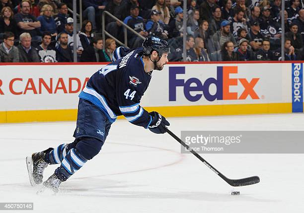 Zach Bogosian of the Winnipeg Jets carries the puck up the ice during third period action against the San Jose Sharks at the MTS Centre on November...