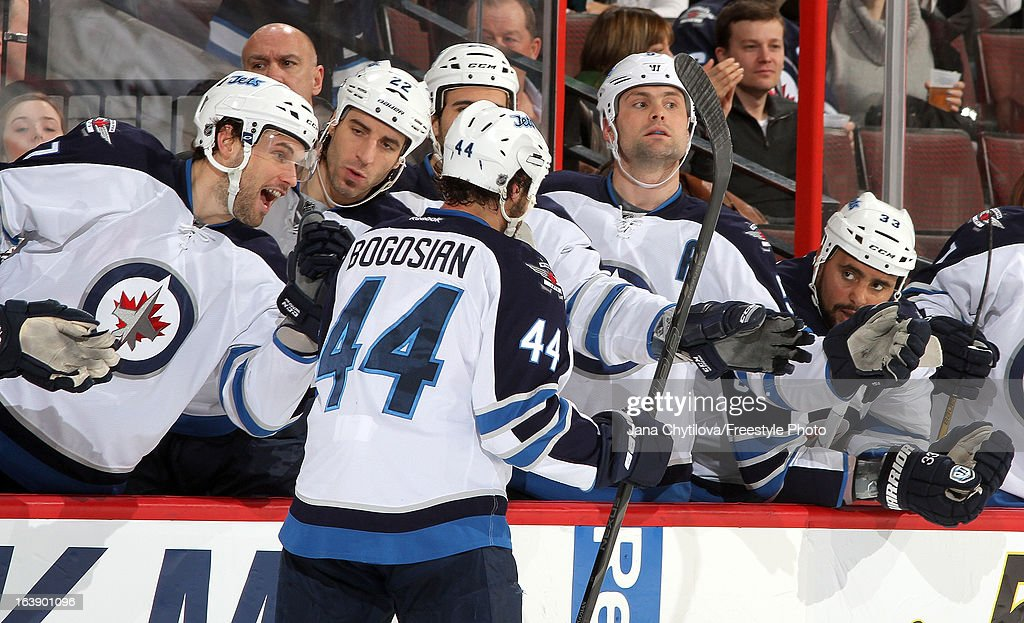 Zach Bogosian #44 of the Winnipeg Jets celebrates his third period goal with team mates Eric Tangradi #27, Chris Thorburn #22, Mark Stuart #5, and Dustin Byfuglien #33, during an NHL game against the Ottawa Senators, at Scotiabank Place, on March 17, 2013 in Ottawa, Ontario, Canada.