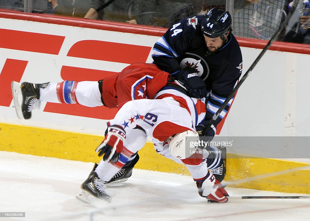 <a gi-track='captionPersonalityLinkClicked' href=/galleries/search?phrase=Zach+Bogosian&family=editorial&specificpeople=4195061 ng-click='$event.stopPropagation()'>Zach Bogosian</a> #44 of the Winnipeg Jets knocks down Steve Oleksy #61 of the Washington Capitals during second-period action at the MTS Centre on March 21, 2013 in Winnipeg, Manitoba, Canada.