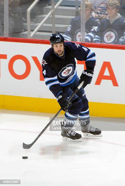 Zach Bogosian of the Winnipeg Jets plays the puck up the ice during second period action against the Florida Panthers at the MTS Centre on December...