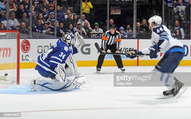Zach Bogosian of the Winnipeg Jets scores the gamewinning goal on James Reimer of the Toronto Maple Leafs during NHL shootout game action March 16...
