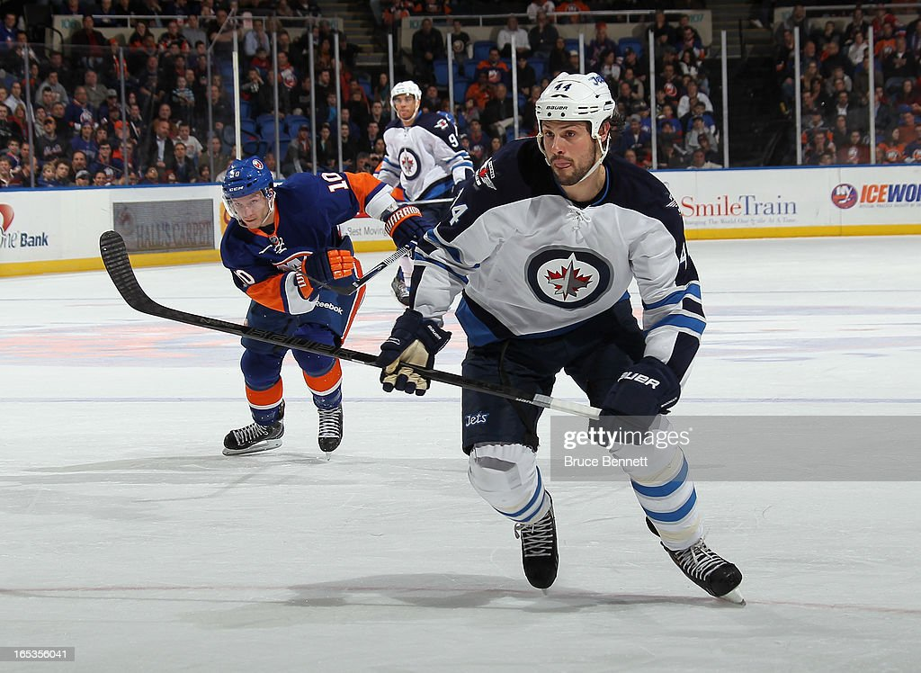 Zach Bogosian #44 of the Winnipeg Jets skates against the New York Islanders at the Nassau Veterans Memorial Coliseum on April 2, 2013 in Uniondale, New York. The Islanders defeated the Jets 5-2.