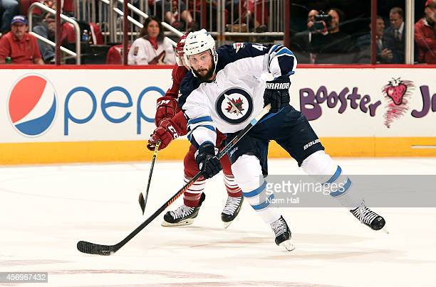 Zach Bogosian of the Winnipeg Jets skates with the puck against the Arizona Coyotes during the third period at Gila River Arena on October 9 2014 in...