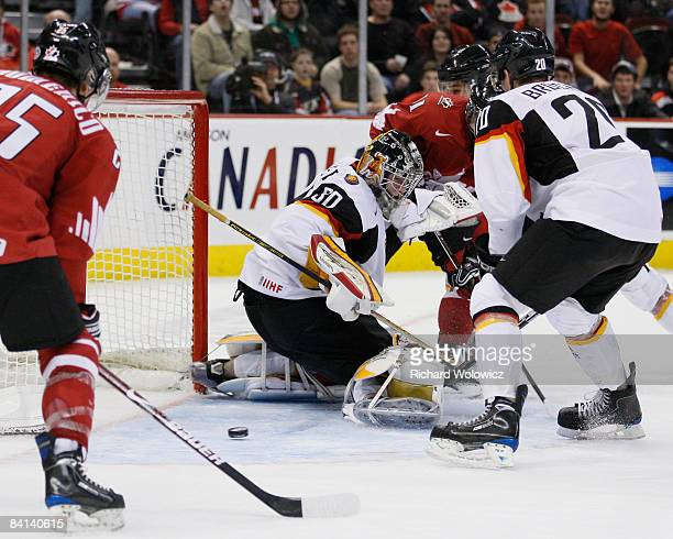 Zach Boychuk of Team Canada gets a shot through the legs of Philipp Grubauer of Team Germany during the IIHF World Junior Championships at Scotiabank...