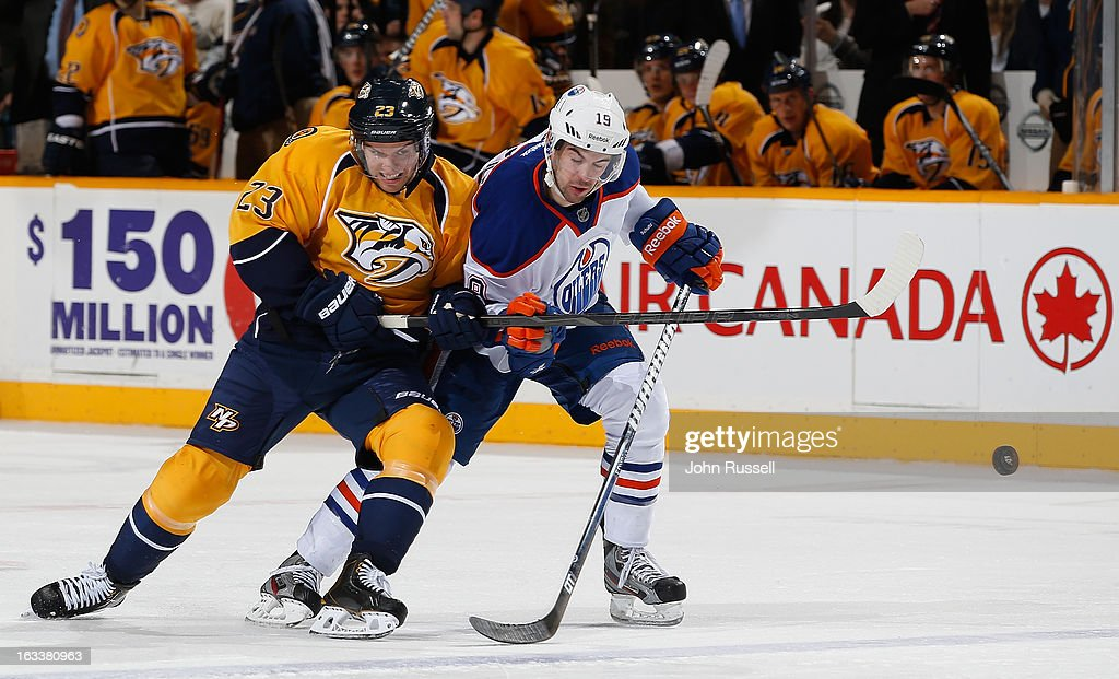 Zach Boychuk #23 of the Nashville Predators battles against <a gi-track='captionPersonalityLinkClicked' href=/galleries/search?phrase=Justin+Schultz&family=editorial&specificpeople=5370958 ng-click='$event.stopPropagation()'>Justin Schultz</a> #19 of the Edmonton Oilers during an NHL game at the Bridgestone Arena on March 8, 2013 in Nashville, Tennessee.