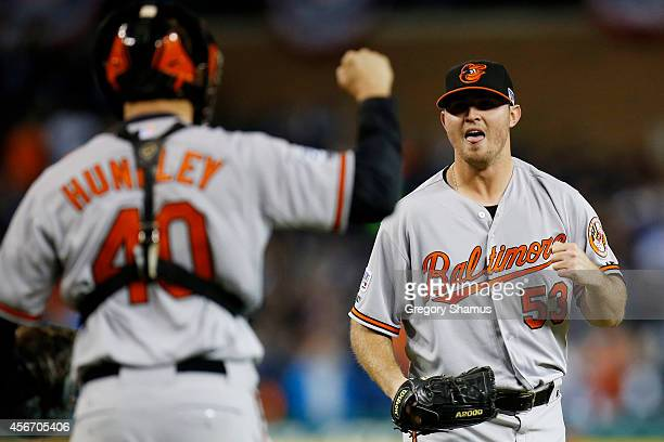 Zach Britton and Nick Hundley of the Baltimore Orioles celebrate their 2 to 1 win over the Detroit Tigers to sweep the series in Game Three of the...