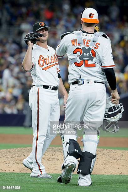 Zach Britton of the Baltimore Orioles and the American League is congratulated by Matt Wieters of the Baltimore Orioles after defeating the National...