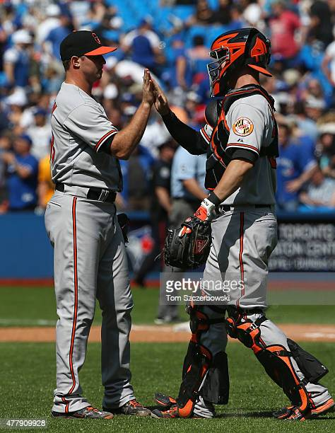 Zach Britton of the Baltimore Orioles celebrates their victory with Caleb Joseph during MLB game action against the Toronto Blue Jays on June 20 2015...