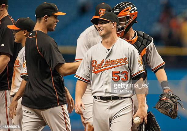 Zach Britton of the Baltimore Orioles celebrates with teammates after getting the save in the Orioles win over the Tampa Bay Rays on April 7 2015 at...