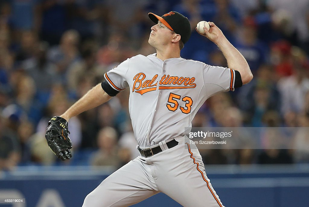 <a gi-track='captionPersonalityLinkClicked' href=/galleries/search?phrase=Zach+Britton&family=editorial&specificpeople=7091505 ng-click='$event.stopPropagation()'>Zach Britton</a> #53 of the Baltimore Orioles delivers a pitch in the ninth inning during MLB game action against the Toronto Blue Jays on August 7, 2014 at Rogers Centre in Toronto, Ontario, Canada.