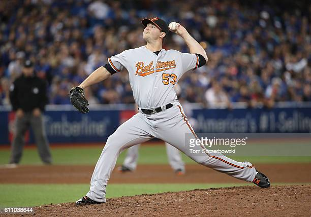 Zach Britton of the Baltimore Orioles delivers a pitch in the ninth inning during MLB game action against the Toronto Blue Jays on September 28 2016...