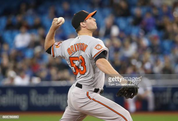 Zach Britton of the Baltimore Orioles delivers a pitch in the ninth inning during MLB game action against the Toronto Blue Jays at Rogers Centre on...