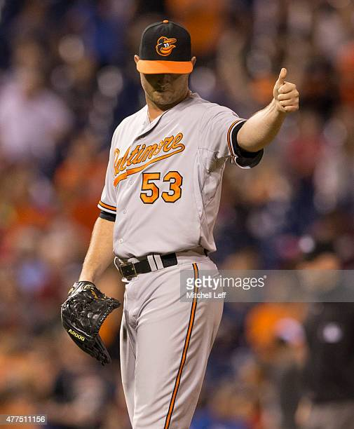 Zach Britton of the Baltimore Orioles gives a thumbs up after earning the save against the Philadelphia Phillies on June 17 2015 at the Citizens Bank...