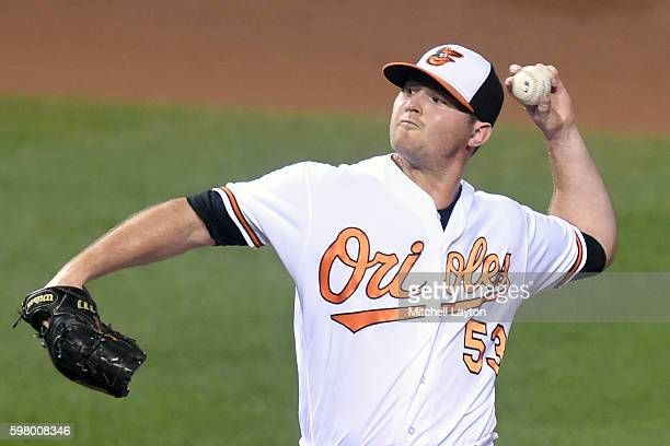 Zach Britton of the Baltimore Orioles pitches in the ninth inning for his 39th save during a baseball game against the Toronto Blue Jays at Oriole...