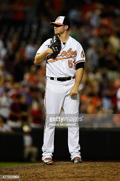 Zach Britton of the Baltimore Orioles prepares to throw a pitch to a Boston Red Sox batter in the ninth inning during a baseball game at Oriole Park...