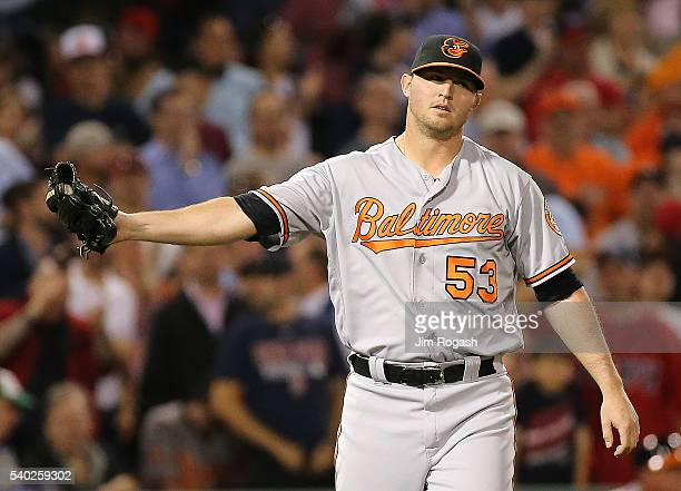 Zach Britton of the Baltimore Orioles reacts after he gave up a run in the eighth inning against the Boston Red Sox at Fenway Park on June 14 2016 in...
