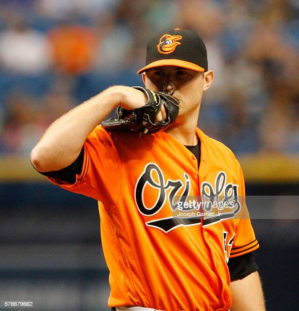 Zach Britton of the Baltimore Orioles reads pitching signals during the bottom of the ninth inning of the Baltimore Orioles and the Tampa Bay Rays...