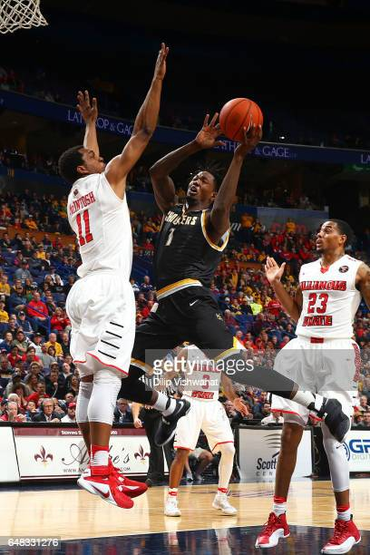 Zach Brown of the Wichita State Shockers drives to the basket against MiKyle McIntosh of the Illinois State Redbirds during the Missouri Valley...