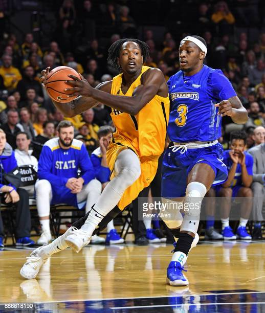 Zach Brown of the Wichita State Shockers drives to the basket against Chris Howell of the South Dakota State Jackrabbits during the first half on...