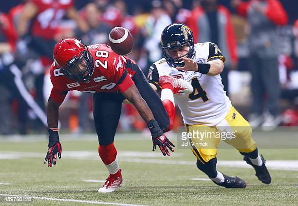 Zach Collaros of the Hamilton TigerCats and Brandon Smith of the Calgary Stampeders scramble after the fumbled football during the 102nd Grey Cup...