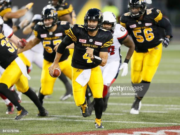 Zach Collaros of the Hamilton TigerCats carries the ball against the Ottawa Redblacks during a CFL game at Tim Hortons Field on August 18 2017 in...