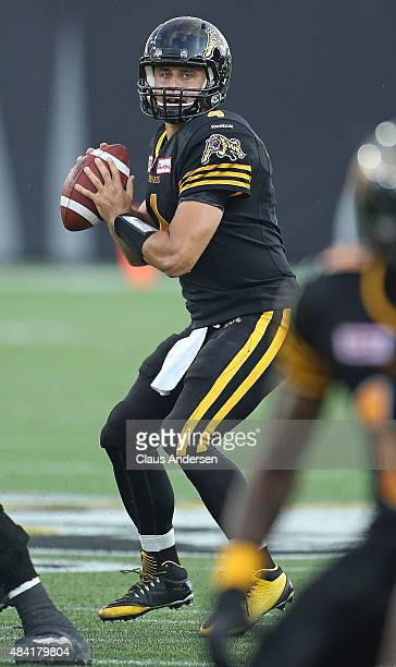 Zach Collaros of the Hamilton TigerCats fires a pass against the BC Lions during a CFL football game at Tim Hortons Field on August 15 2015 in...