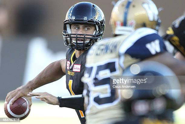 Zach Collaros of the Hamilton TigerCats fires a pass against the Winnipeg Blue Bombers during a CFL football game at Tim Hortons Field on August 9...
