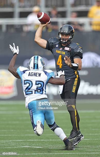Zach Collaros of the Hamilton Tigercats fires a pass over Vincent Agnew of the Toronto Argonauts in a CFL football game at Tim Hortons Field on...