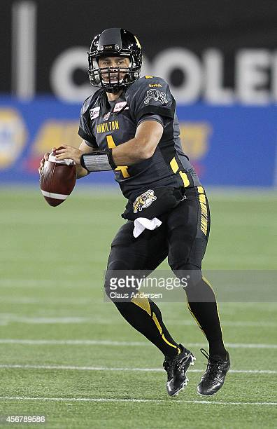 Zach Collaros of the Hamilton Tigercats gets set to fire a pass against the BC Lions in a CFL football game at Tim Hortons Field on October 4 2014 in...