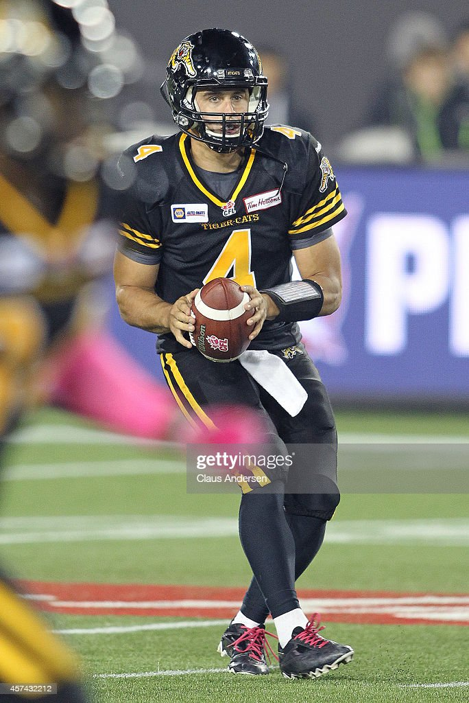 <a gi-track='captionPersonalityLinkClicked' href=/galleries/search?phrase=Zach+Collaros&family=editorial&specificpeople=6237743 ng-click='$event.stopPropagation()'>Zach Collaros</a> #4 of the Hamilton Tiger-cats gets set to make a play against the Ottawa Redblacks in a CFL game at Tim Hortons Field on October 17, 2014 in Hamilton, Ontario, Canada. The Tiger-cats defeated the Redblacks 16-6.