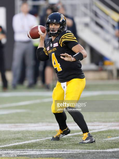 Zach Collaros of the Hamilton TigerCats goes to throw a pass against the Ottawa Redblacks during a CFL game at Tim Hortons Field on August 18 2017 in...